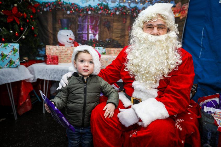 Cameron McGinlay meets Santa in Monifieth.