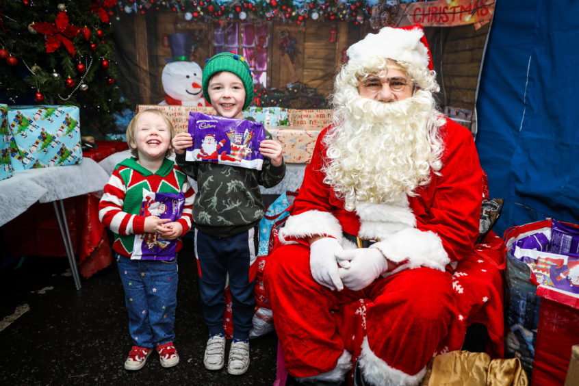 Santa meets Miriam and Elliot in Monifieth.