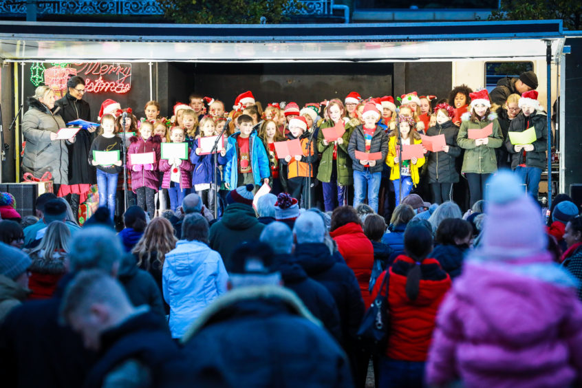 The choir sings Christmas Carols at the Monifieth Christmas lights switch-on.