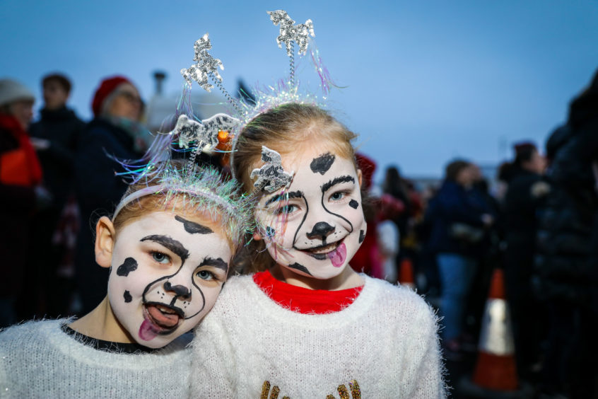 Lucie & Ellie from Tolmie Dance School pose with their doggy makeup on at the Monifieth Christmas lights switch-on.