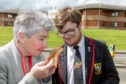 Councillor Mary Lockhart and pupil Bailey-Lee Robb (17) with one of the sub-standard sandwiches being served.