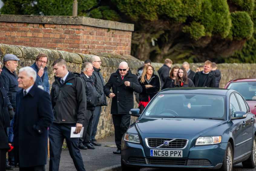 Family, friends, colleagues and well wishers gather for Councillor Wullie Clark's funeral.