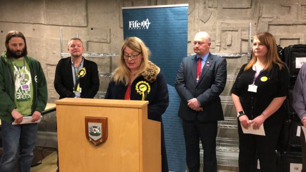 Sharon Green-Wilson at the podium after her by-election win.