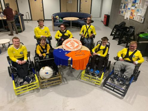 Tayside Dynamos members front row (from left): Nicky Duncan, Alexander Johnstone, Eythan Galloway, Logan Mitchelson. Back row: Kein Speed, Kristin MacMaster, Liam Ritchie.
