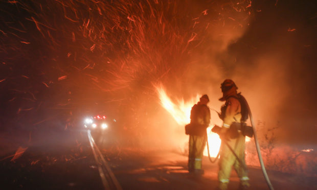 Firefighters battle a wildfire in Riverside, California.