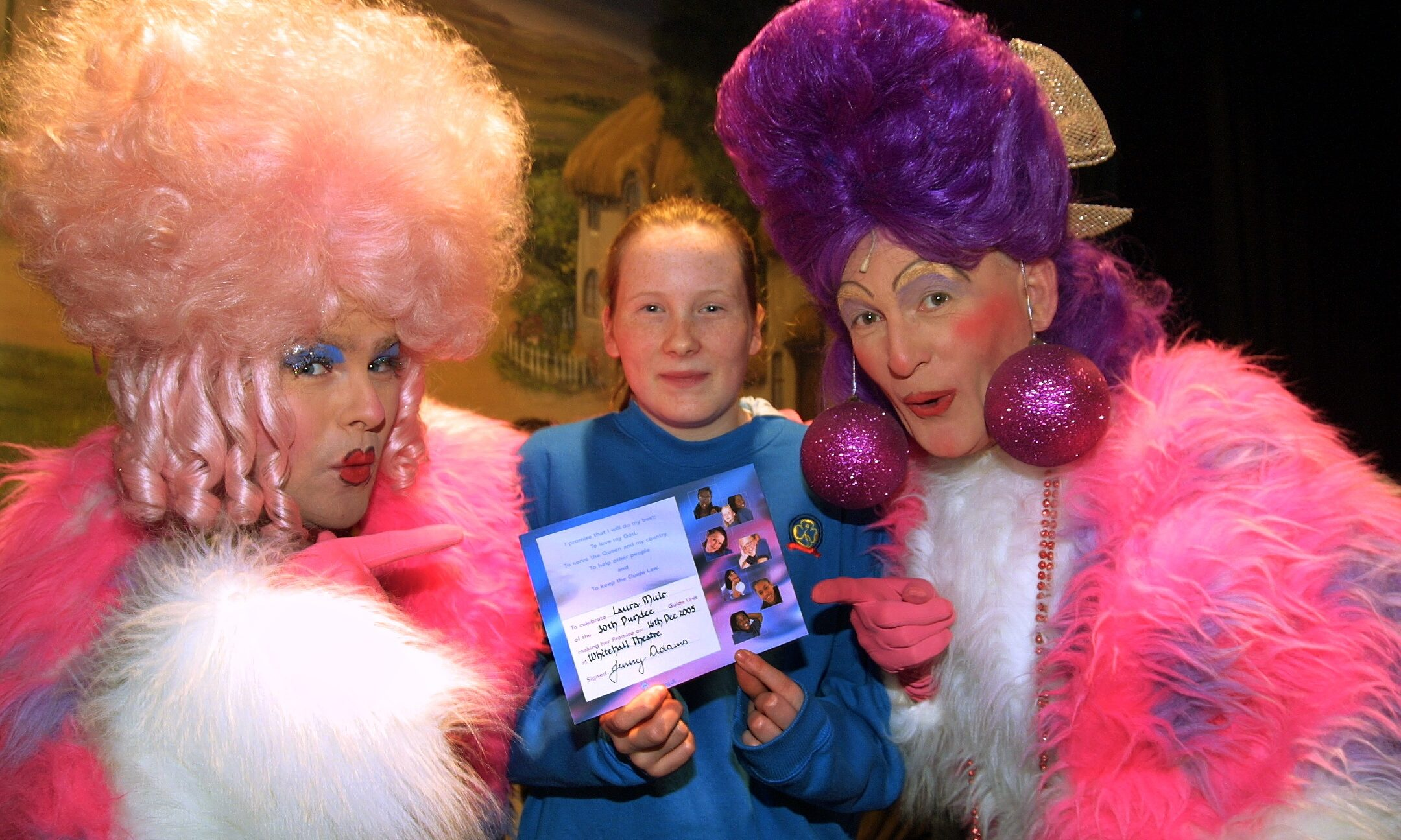 Laura Muir of the 30th Dundee Guides with ugly sisters Daisy - Ewan Campbell (left) and Dandylion - Roger Buist, of the Downfield Musical Society after making her promise on stage at the Whitehall Theatre in 2005