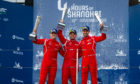 Jonny Adam (right) on the WEC podium with TF Sport teammates Eastwood and Yolic.