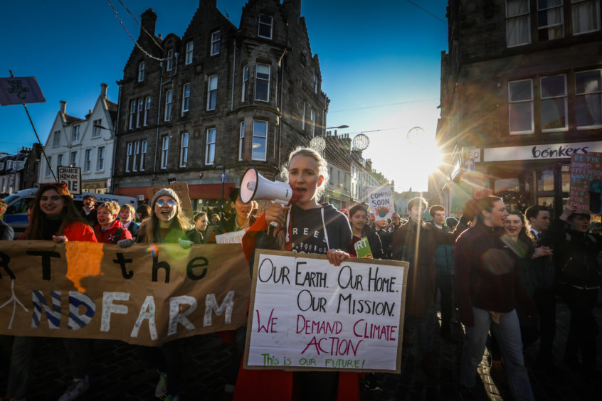 Climate strikers in St Andrews led by organiser Lea Weimann.
