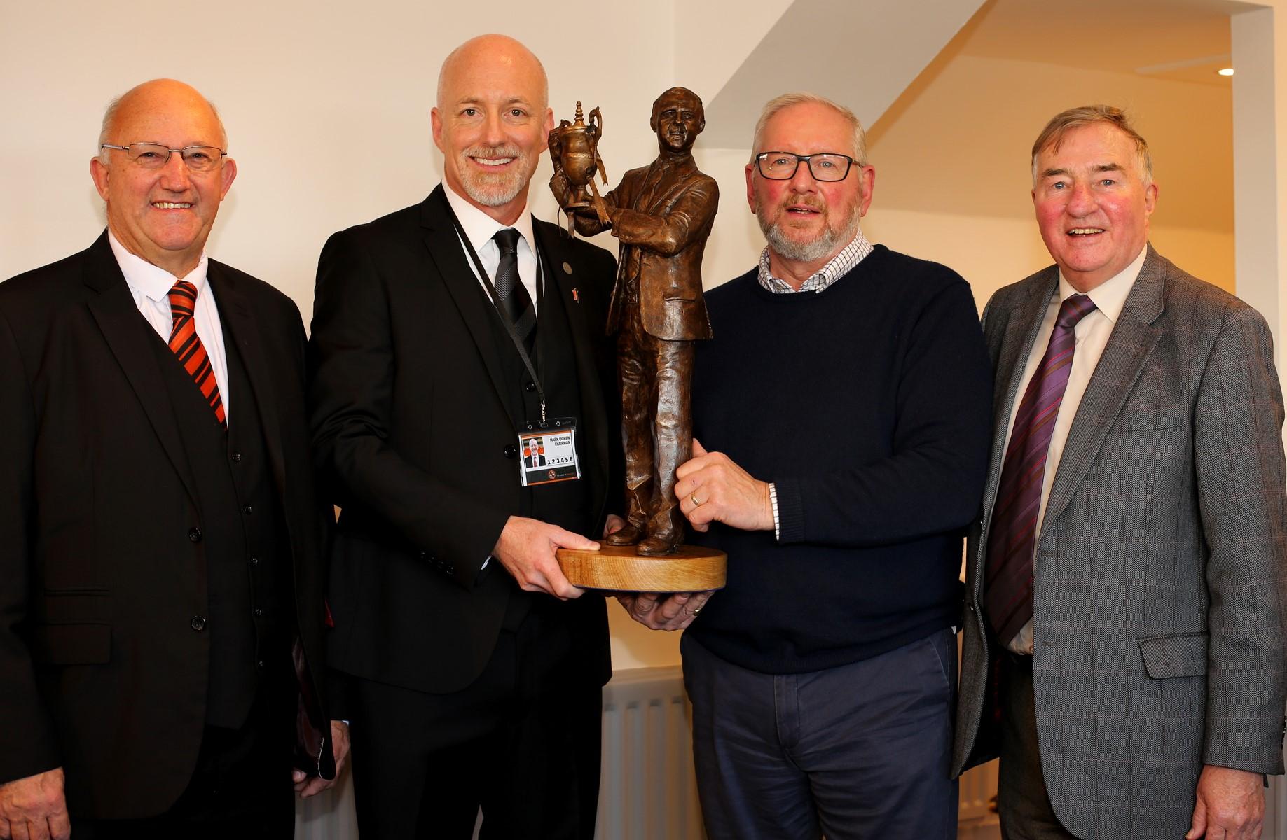 David Dorward, Mark Ogren, Alan Heriott and George Haggarty with the replica statue.