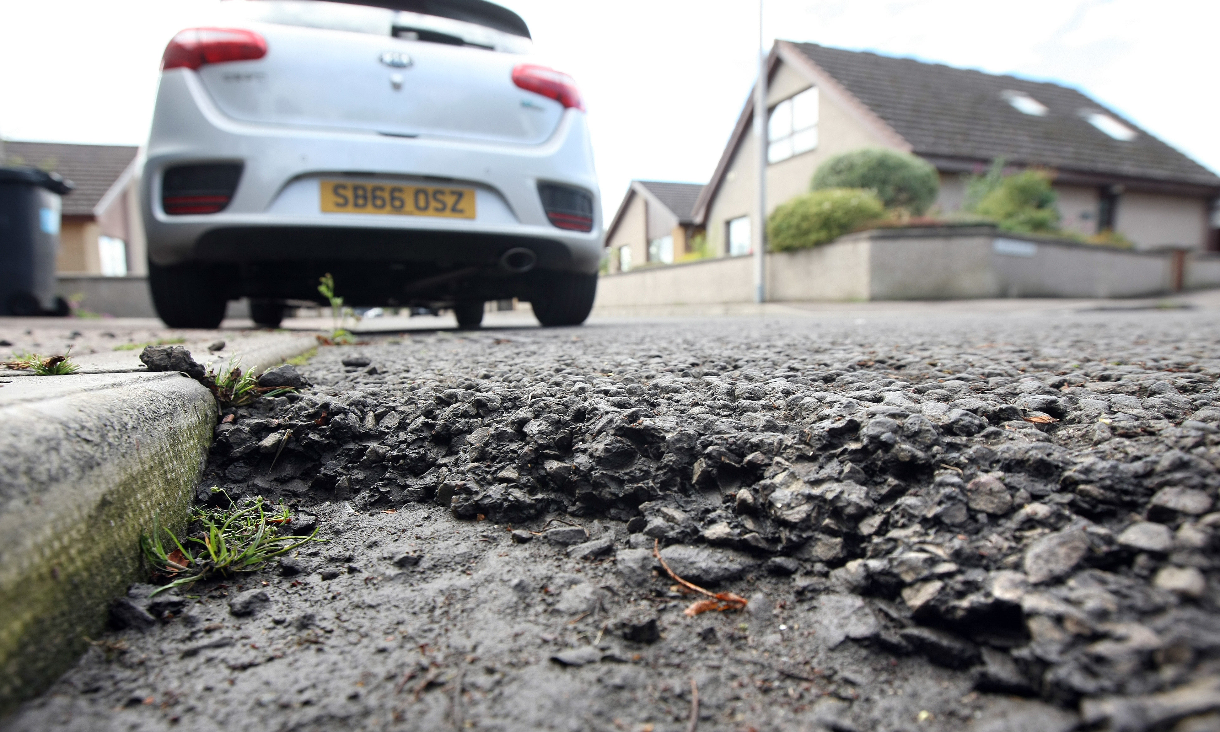 Courier News. Angus story. Picture shows; potholes and cracks in the road in Ireland Street (beside junction with Carlogie Road) for story about Angus pothole hotline. Monday, 31st July, 2017.