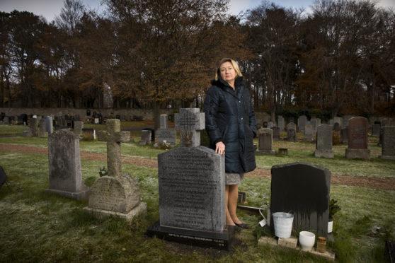 Anna Pawliszewska at the grave of her great grandfather, Polish General Mikolaj Osikowski in Hayfield Cemetery Kirkcaldy