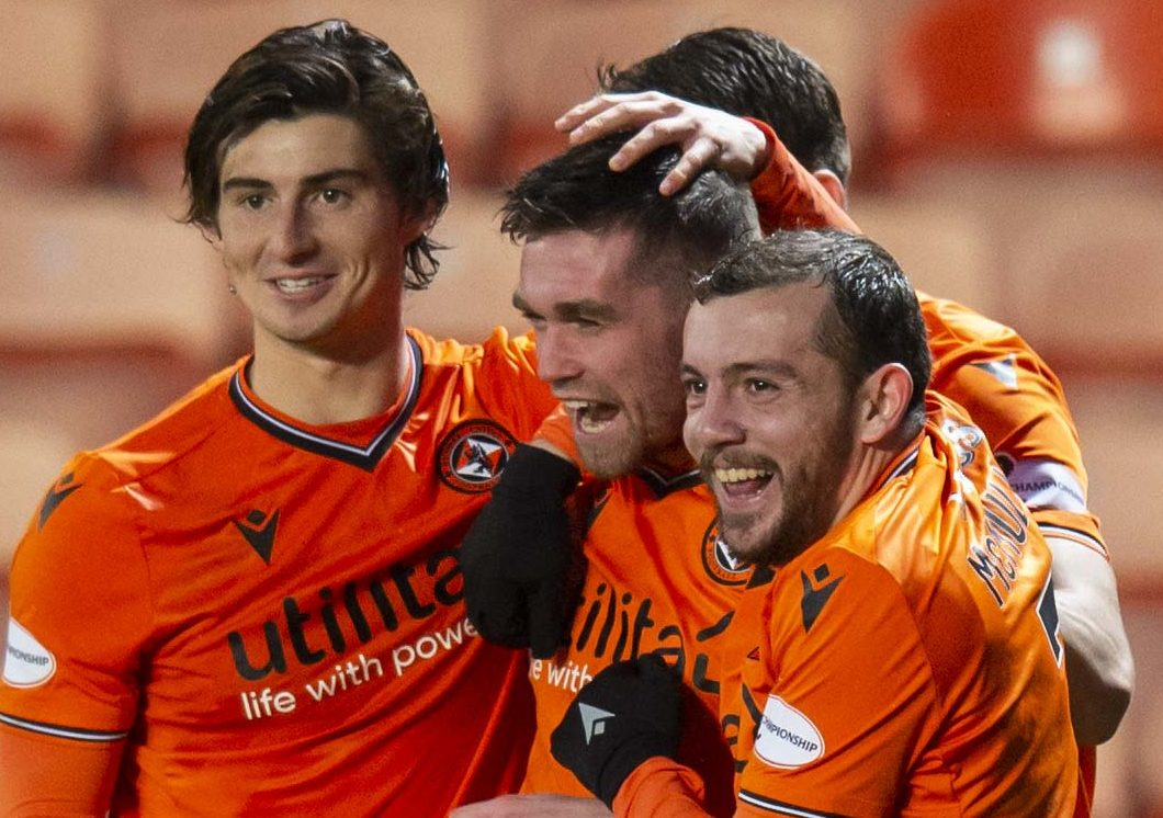 The Dundee United players celebrate Sam Stanton's goal.