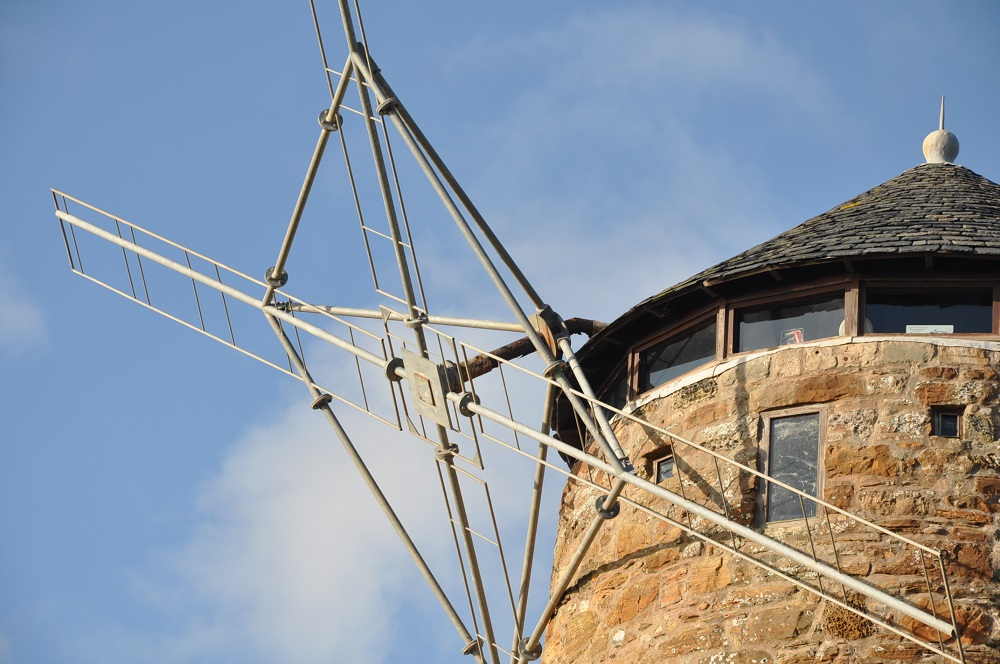 The structural damage visible on the windmill.