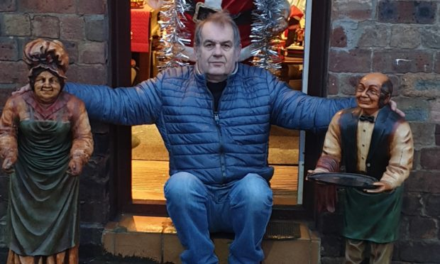 Derek Pook, owner of Clepington Antiques and Collectables Centre, with the statues.