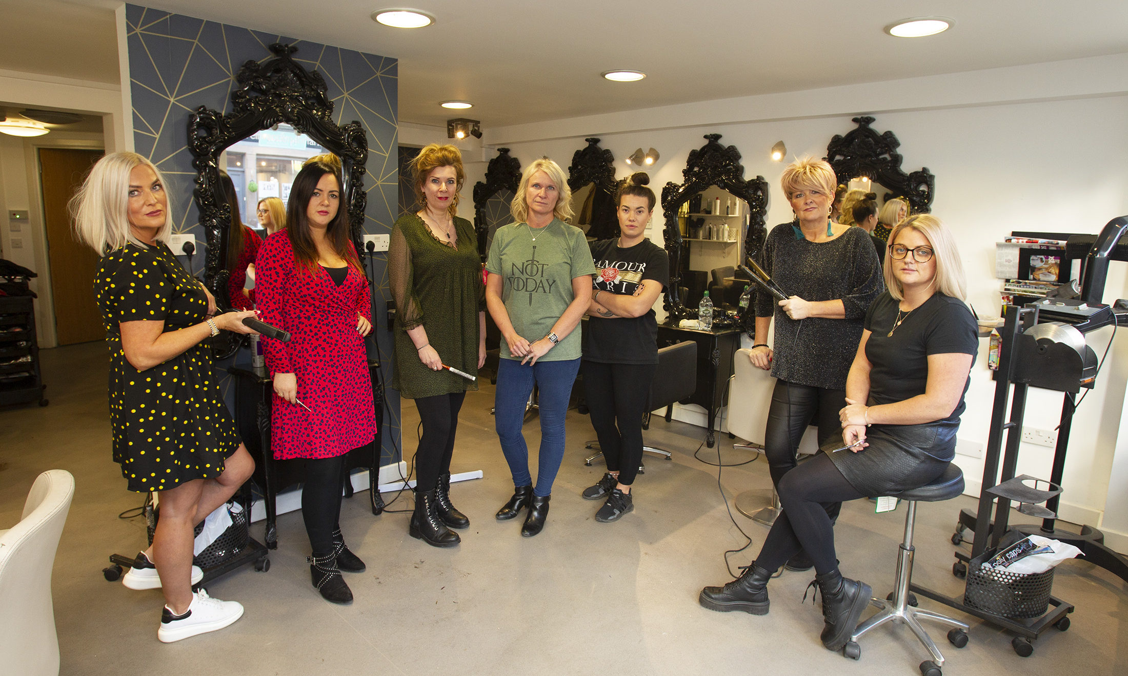 """CR0016417  Pic shows some of the staff...  Staff at successful Forfar hairdressers were shocked yesterday when sheriff officers came into the salon and served them with eviction notices. The 11 strong team were told to leave by December 3 as their landlord had failed to pay his mortgage, while the business itself had never failed to make a payment on time. The team - who serve around 300 clients a week in the """"thriving"""" business has set aside the same date for a staff night out, after celebrating the businesses 10th anniversary last month. Co-owner Linda Mackie said the team were angry: """"It's absolutely devastating . It's going to be a massive loss to the town as it's a busy, busy place."""" Linda happy with pics, and setting up now.   ....Pic Paul Reid"""
