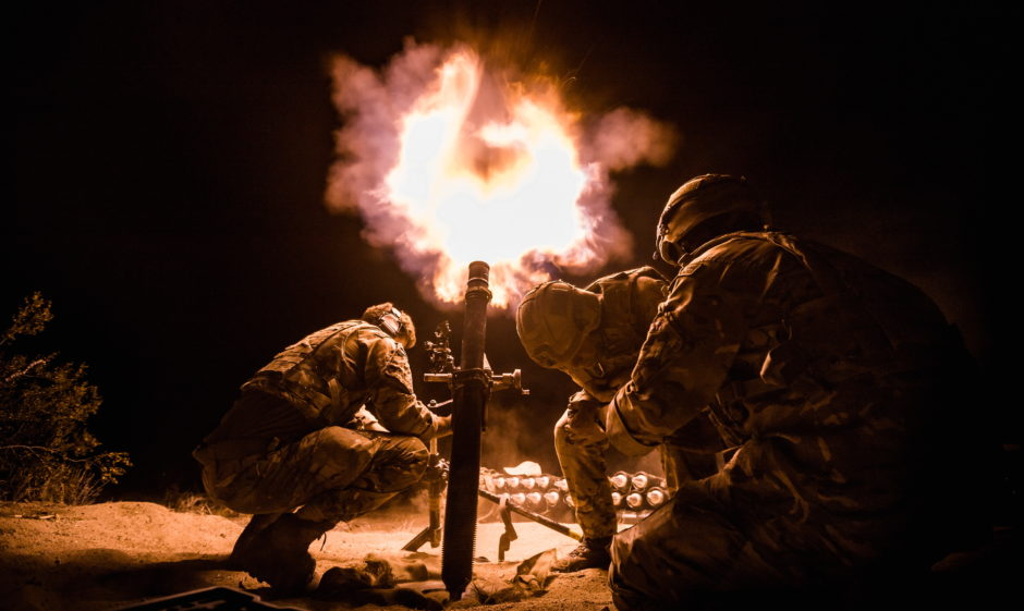 Royal Marines from 40 Commando Mortar Troop conduct a live firing night shoot on Exercise Green Dagger 2019 in the Californian Desert.