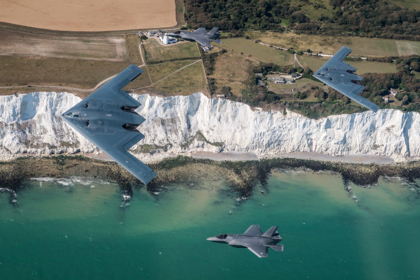 UK F-35 Lightning jets flying in formation with two B-2 Spirit stealth bombers of the United States Air Force, as part of their deployment to RAF Fairford in Gloucestershire.