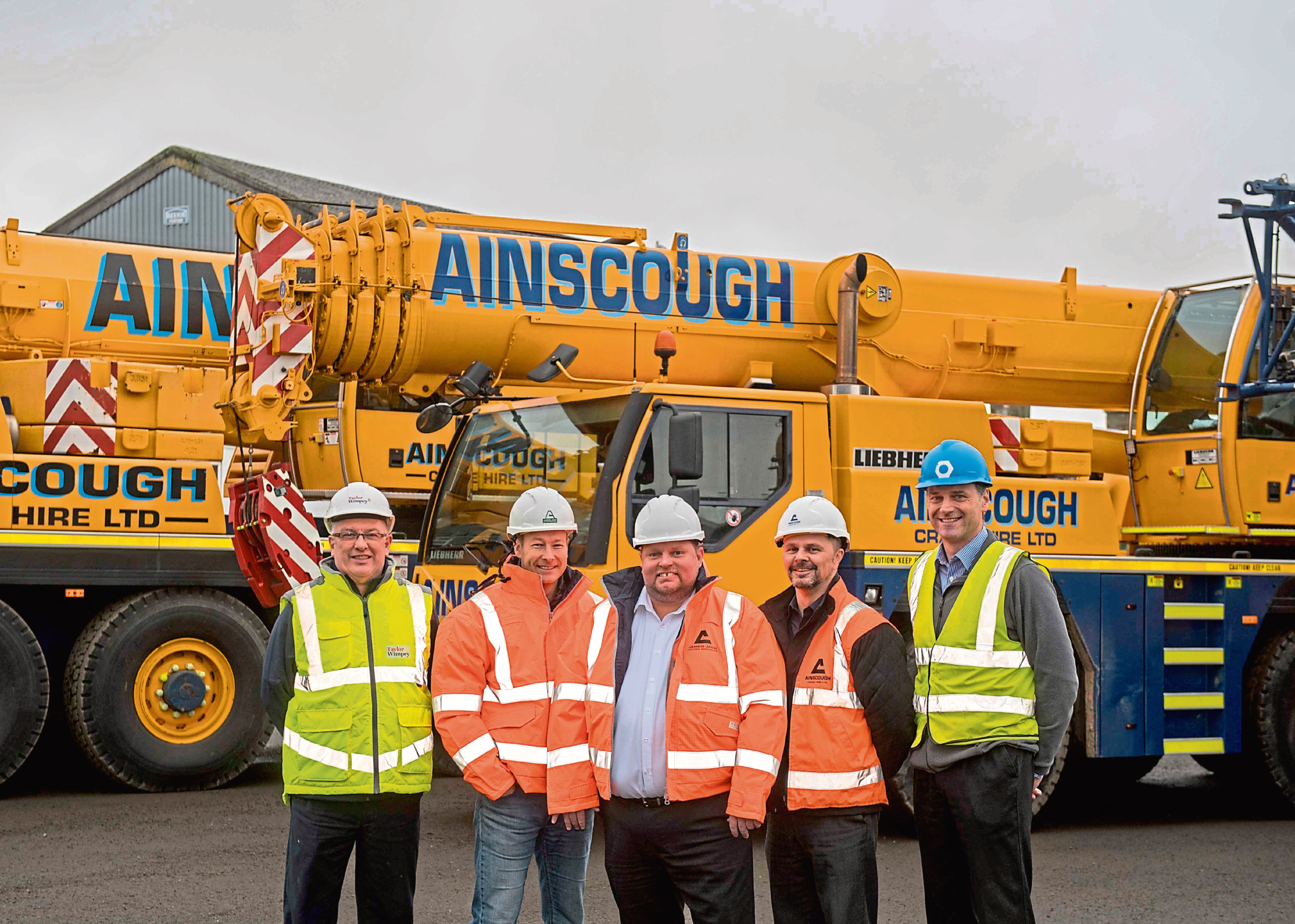 Gavin Egdell (fourth from left) with staff and customers at the new depot.