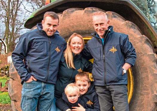 Daniel and Alison Milne with their sons and Norman Milne.