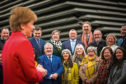 Nicola Sturgeon at V&A Dundee with Chris Law and Stewart Hosie to celebrate their election wins.