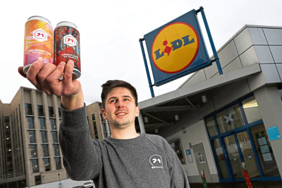71 Brewings Kieran McGuire with the new cans outside Lidl in Dundee. Picture: Stewart Attwood.