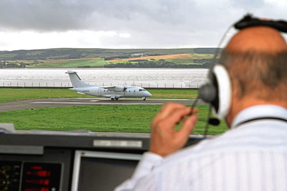 The control tower readies a plane for take-off at Dundee Airport.