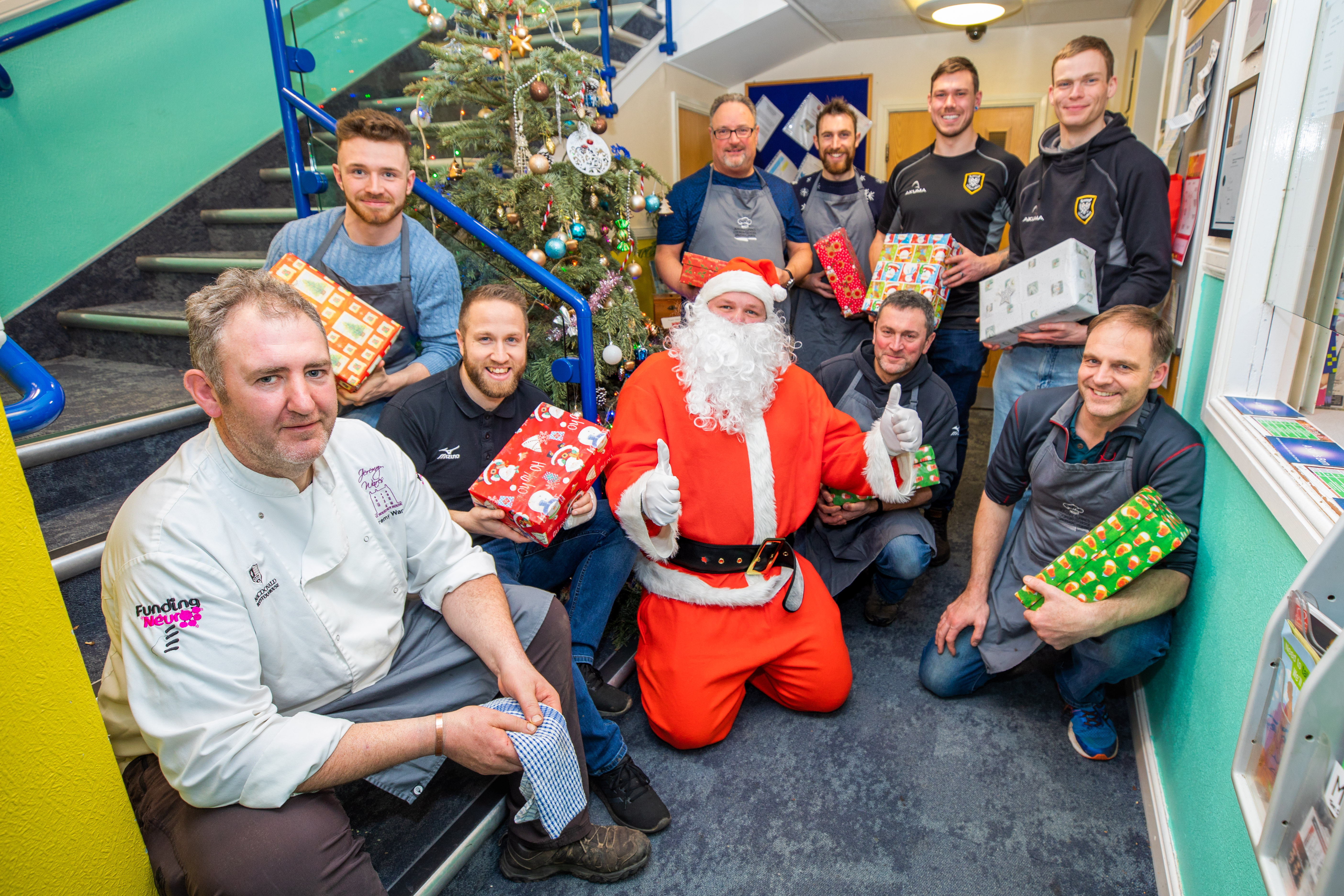 Jeremy Wares (left) alongside members of Perthshire Rugby club and Santa Claus.