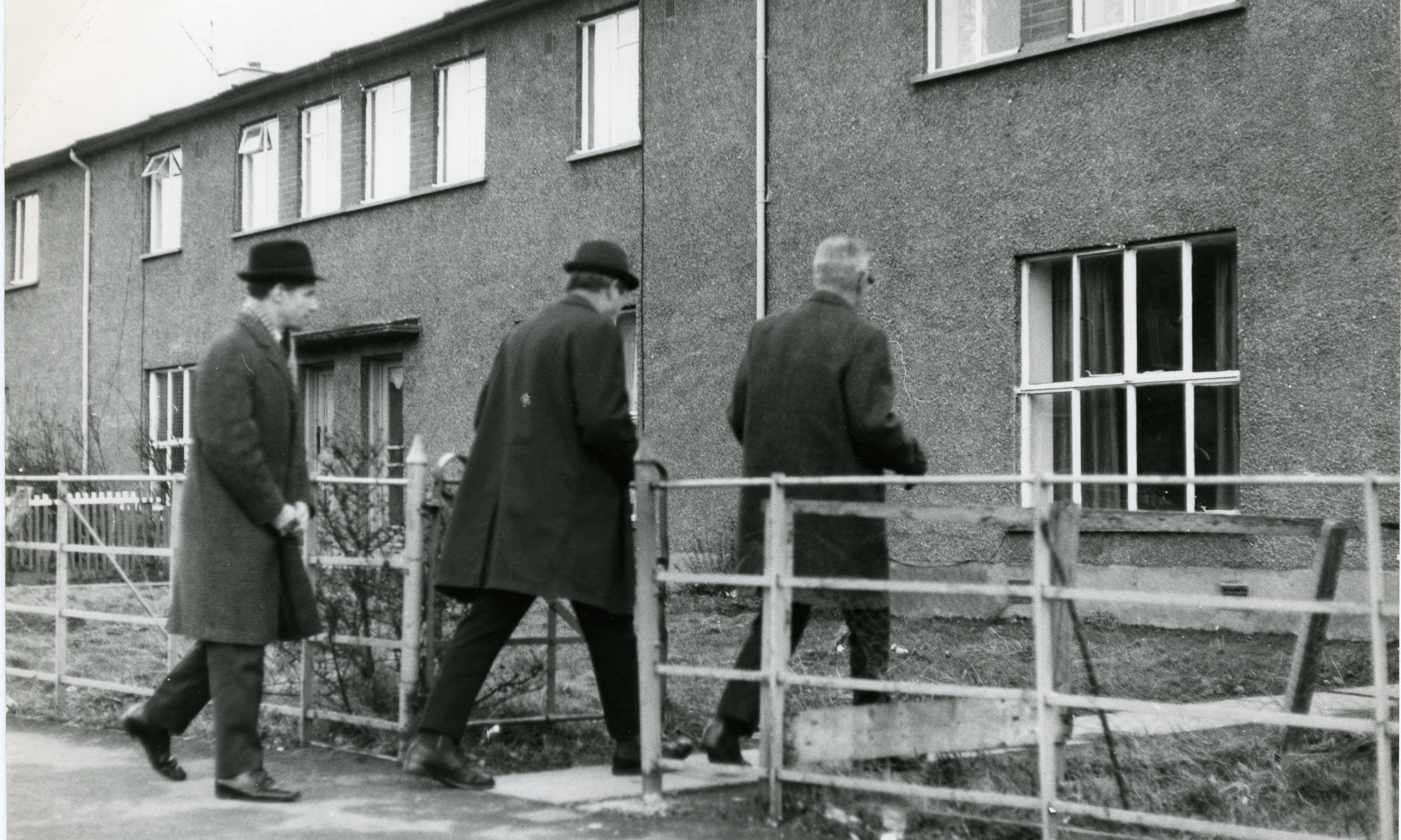 Police enter the house where the body of Harry Falconer was found under the floorboards.