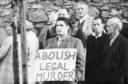 A man wears an 'Abolish Legal Murder' sign following the last-ever hanging in Scotland.