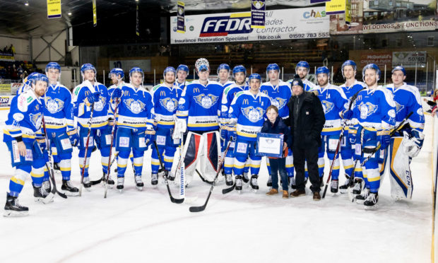 Archie and dad Walter with the Fife Flyers team.