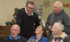 Former St Johnstone Players Visit Perth care Home  Photo, Pictured at North Inch care Home today seated left , Saints Legend Henry Hall shares a memory with right, Bill walker care home resident & Lynn Melrose , St Johnstone Chef with back  Former players Roddy Grant and right Atholl Henderson, now chief executive of the Saints Community trust team .