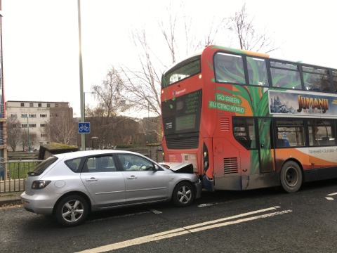 A silver Mazda collided with a 73 bus in Dundee's King Street.