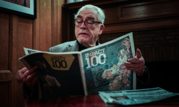 Brian Cox with a copy of The Courier Impact 100