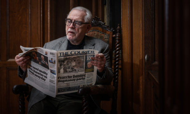 Brian Cox with a copy of The Courier