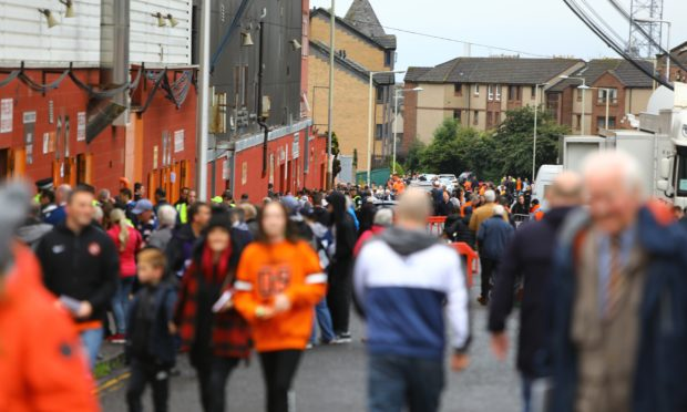 Fans ahead of the Dundee United-Dundee clash in August.