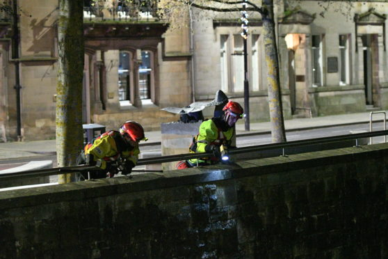 Emergency officers conduct a search of the River Tay in Perth.
