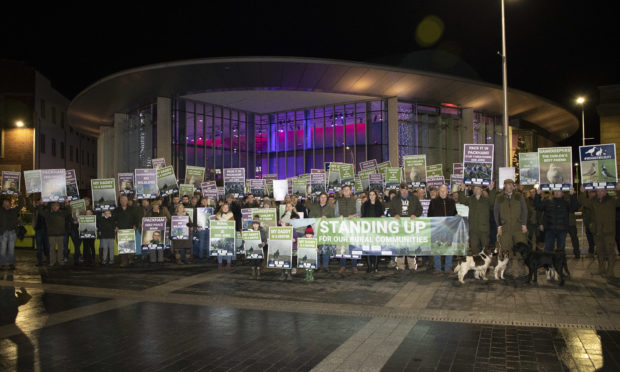 Rural workers and their families gather at Perth Concert Hall to protest against Chris Packham, who was speaking at the venue.