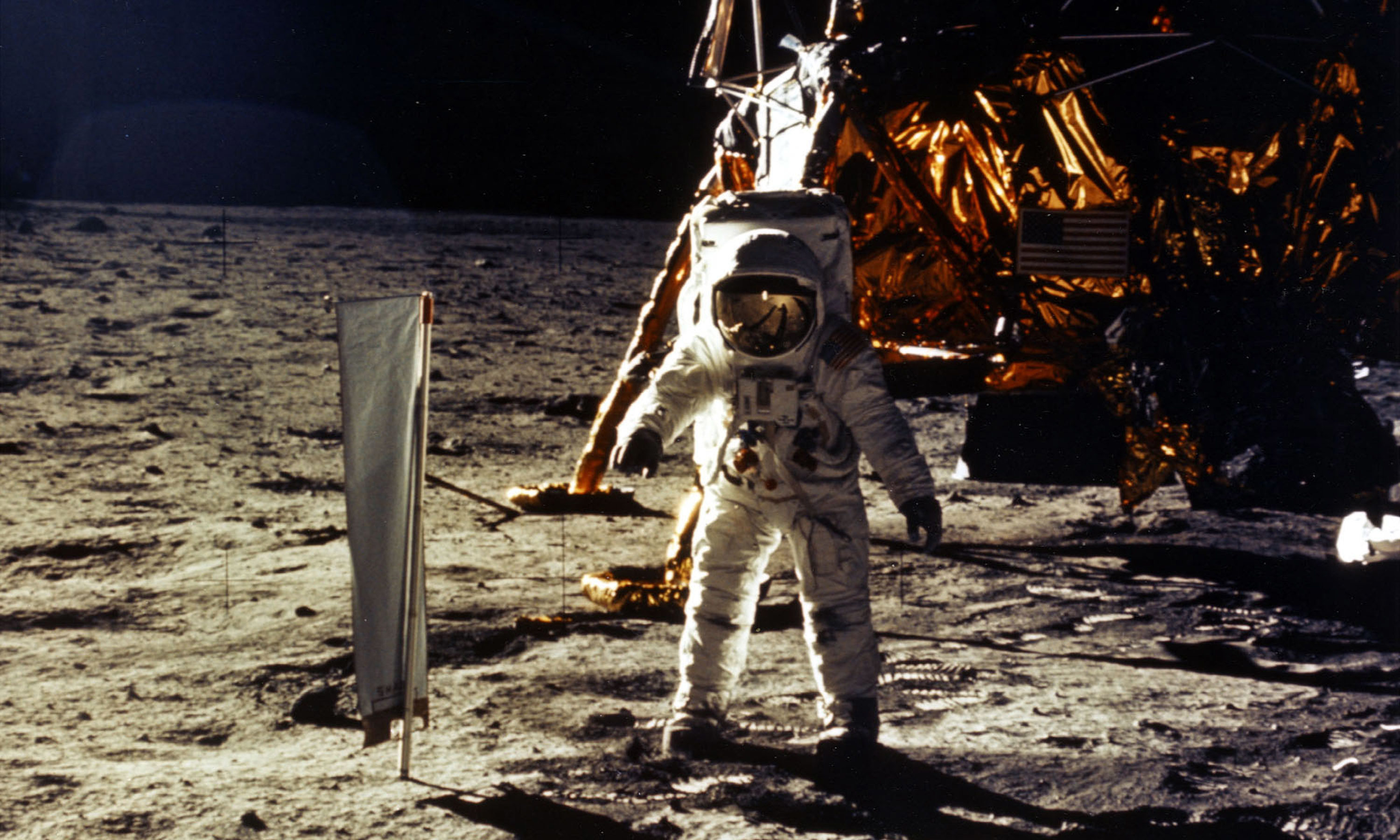 WL Gore assembles wiring for space missions in Dundee. Buzz Aldrin on the moon in 1969. Picture: Getty Images.