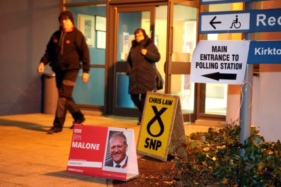 Voters leaving Downfield Primary School on Thursday morning.