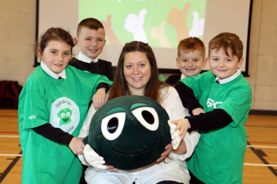 NSPCC Scotland's Heather Whyte, with Ladyloan P4 pupils Alex Gillespie, Jay Smith, Charlie King and Jacob Teasdale and Buddy the mascot.