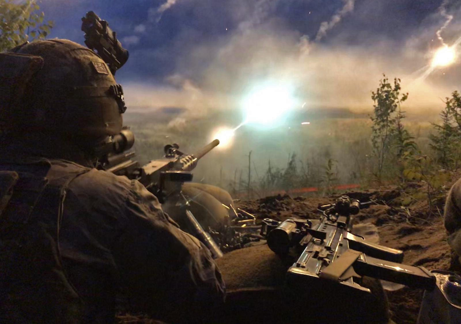 A 45 Commando Royal Marine firing a 50 calibre heavy machine gun in Estonia on Exercise Baltic Protector .