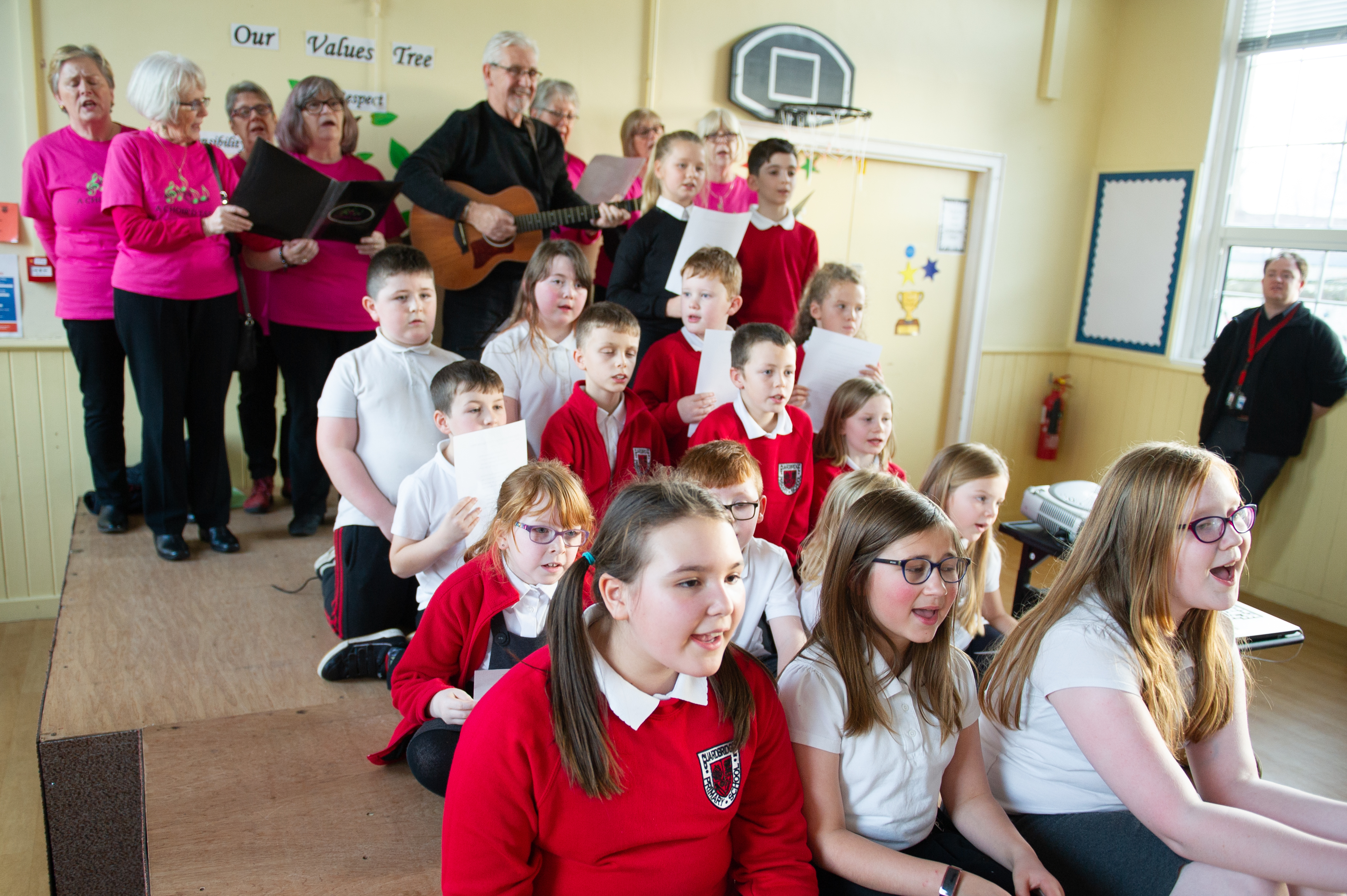Guardbridge Primary pupils and members of A choir'd Taste perform Bill's song.