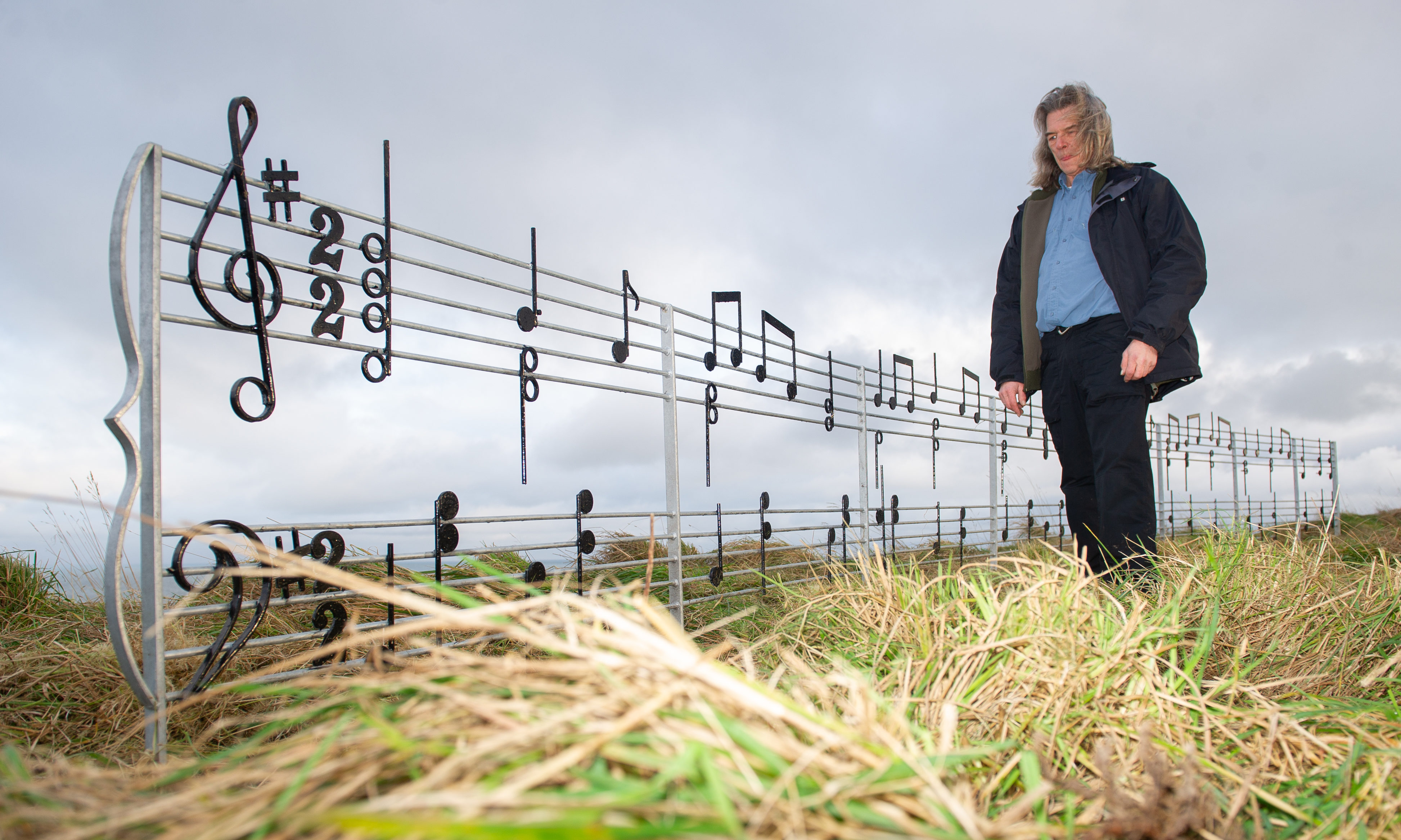 Rab Potter with the musical notes at the installation at their new location on the Seaton Cliffs, Arbroath, 17th December 2019, Kim Cessford / DCT Media.
