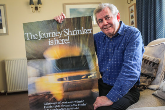 Ian Lamb with a promotional poster.