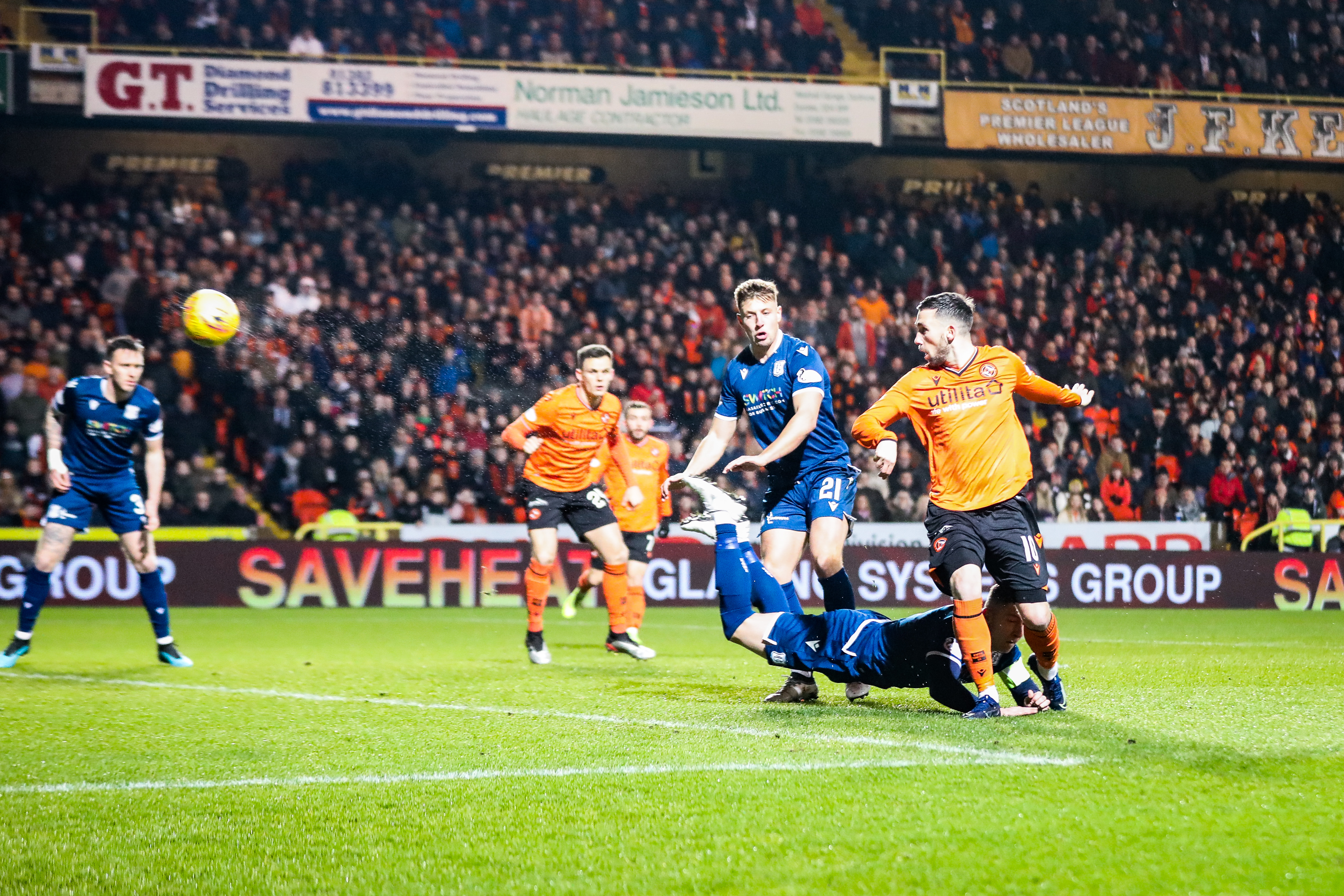 Nicky Clark scores for United in Dundee derby last year