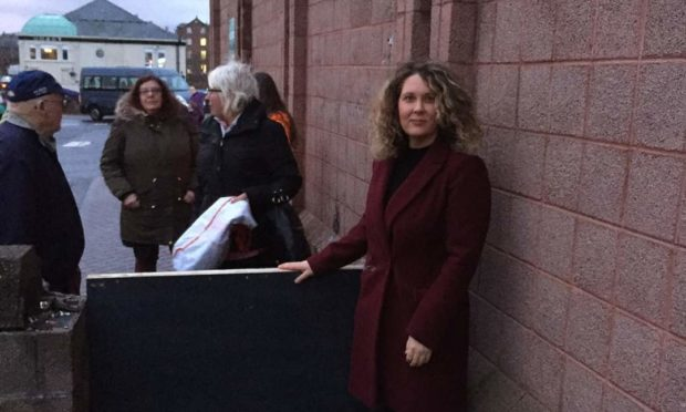 Councillor Lois Speed next to the barricade before it was removed.