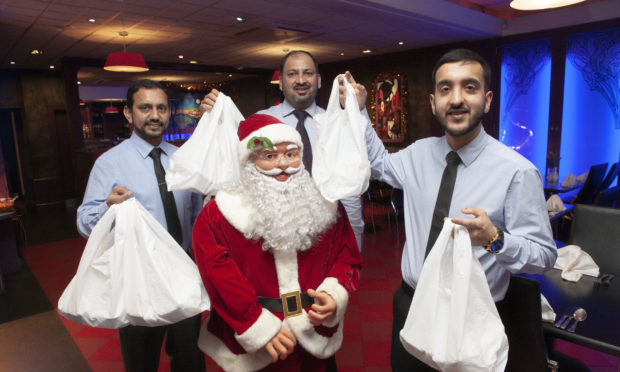 Manzil staff Saved Khan, MZ Abbas and  Gulam Rasool will be handing out free Christmas meals on December 24.