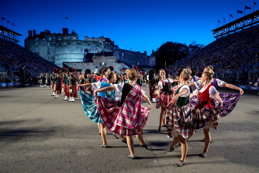 The Tattoo Dance Company, performing traditional Highland dance alongside The Massed Pipes and Drums at the 2019 performance of The Royal Edinburgh Military Tattoo.