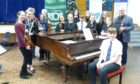Mr Gourlay with young musicians from St Columbas High School.