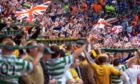 Rangers and Celtic fans taunt each other.